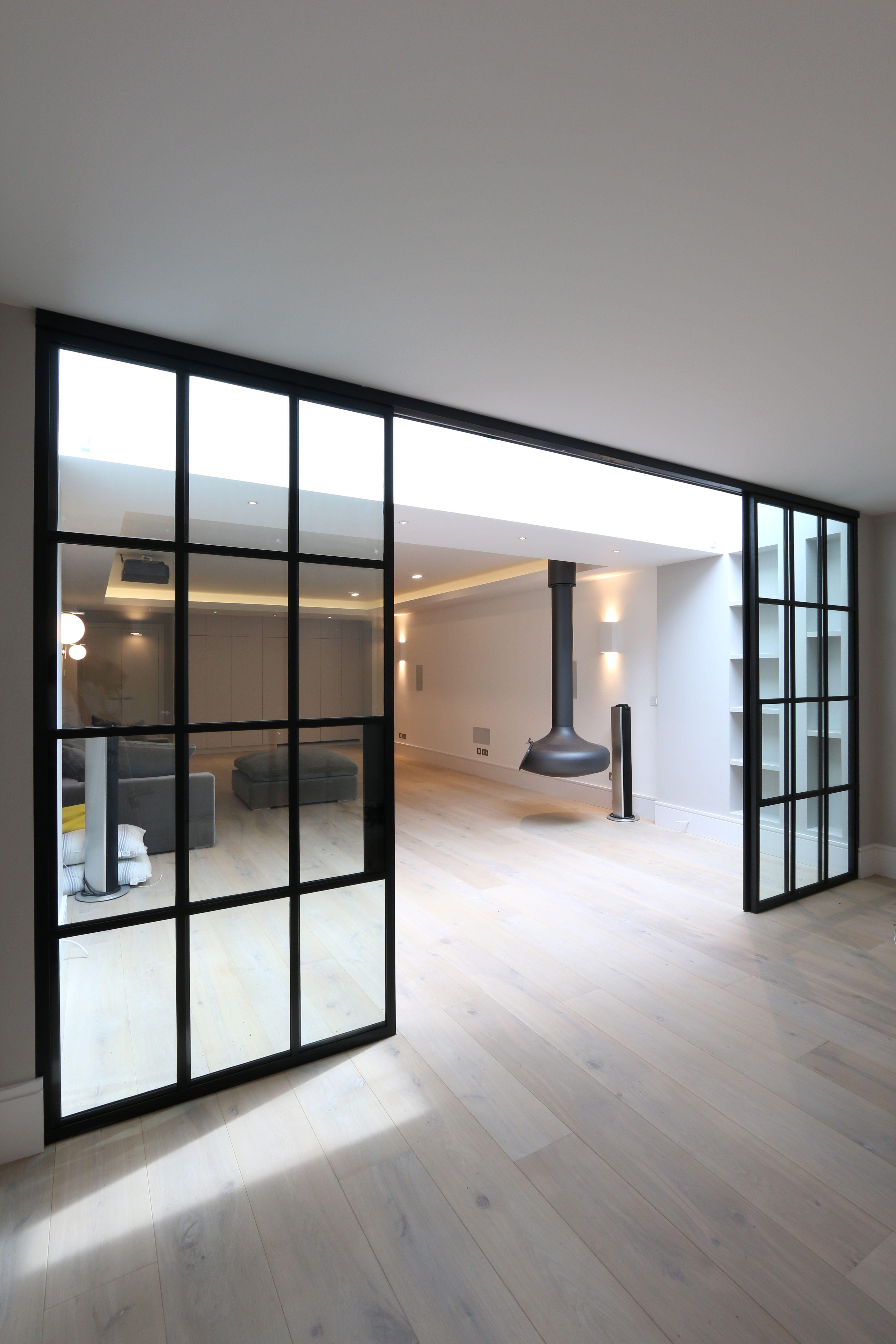 Metal Framed Doors Installed In A Home.