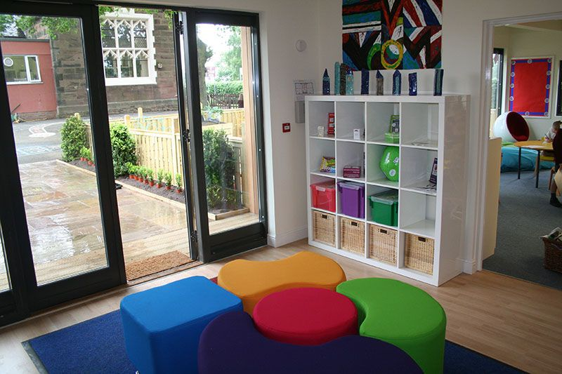 A 5m x 3m garden studio with sliding doors and fied glazed side panels.