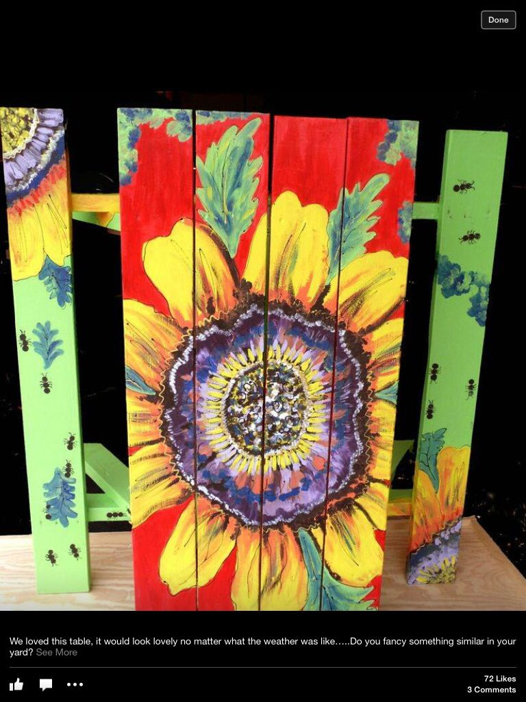 Sunflower mural painted on a picnic table.
