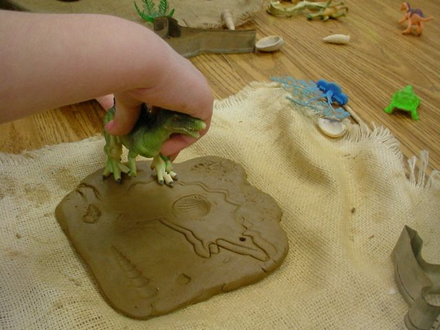 """Kindergarteners learned how to roll a slab of clay and create surface textures,…"