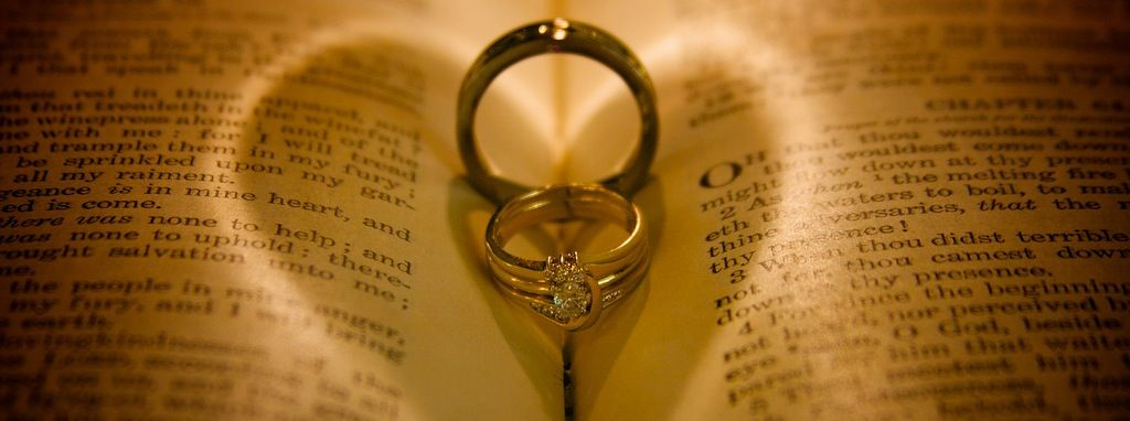 Wedding Rings Sitting In The Bible With Heart Circlesuch A Cool