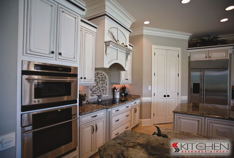 Bright White Kitchen Cabinets With Chocolate Glaze To Accent The Grooves