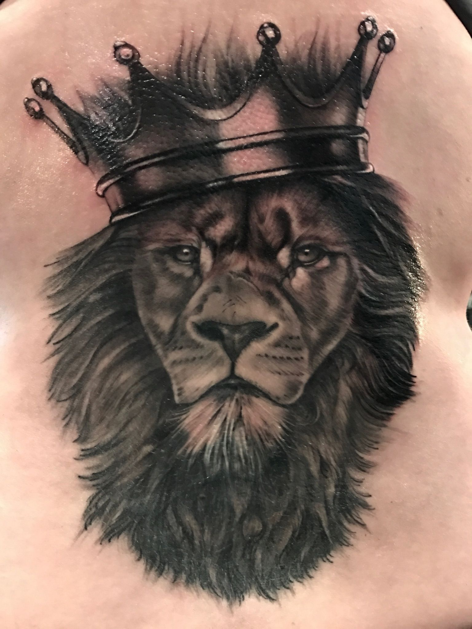 Lion and crown cover up by Lou Bragg Chest tattoo men