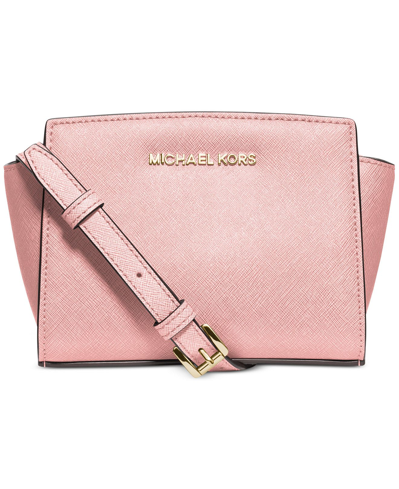 MK Selma Mini Messenger: Mini bags are on trend this season! This bag not  only is on trend but is in a beautiful color for summer called blossom.