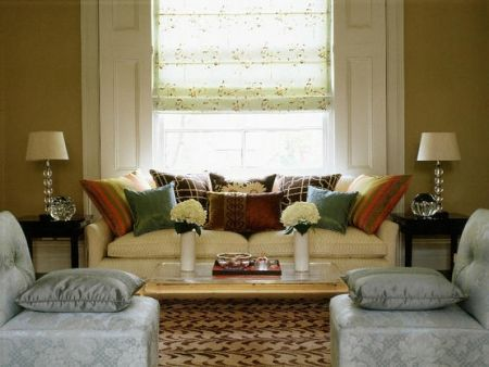 love the low backed couch filled with rich colored pillows but most of all love the symmetry ...stunning room!!!