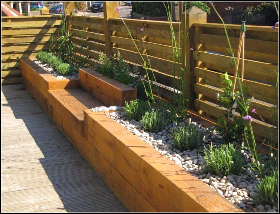 Raised garden beds along fence google search garden for Garden decking ideas pinterest