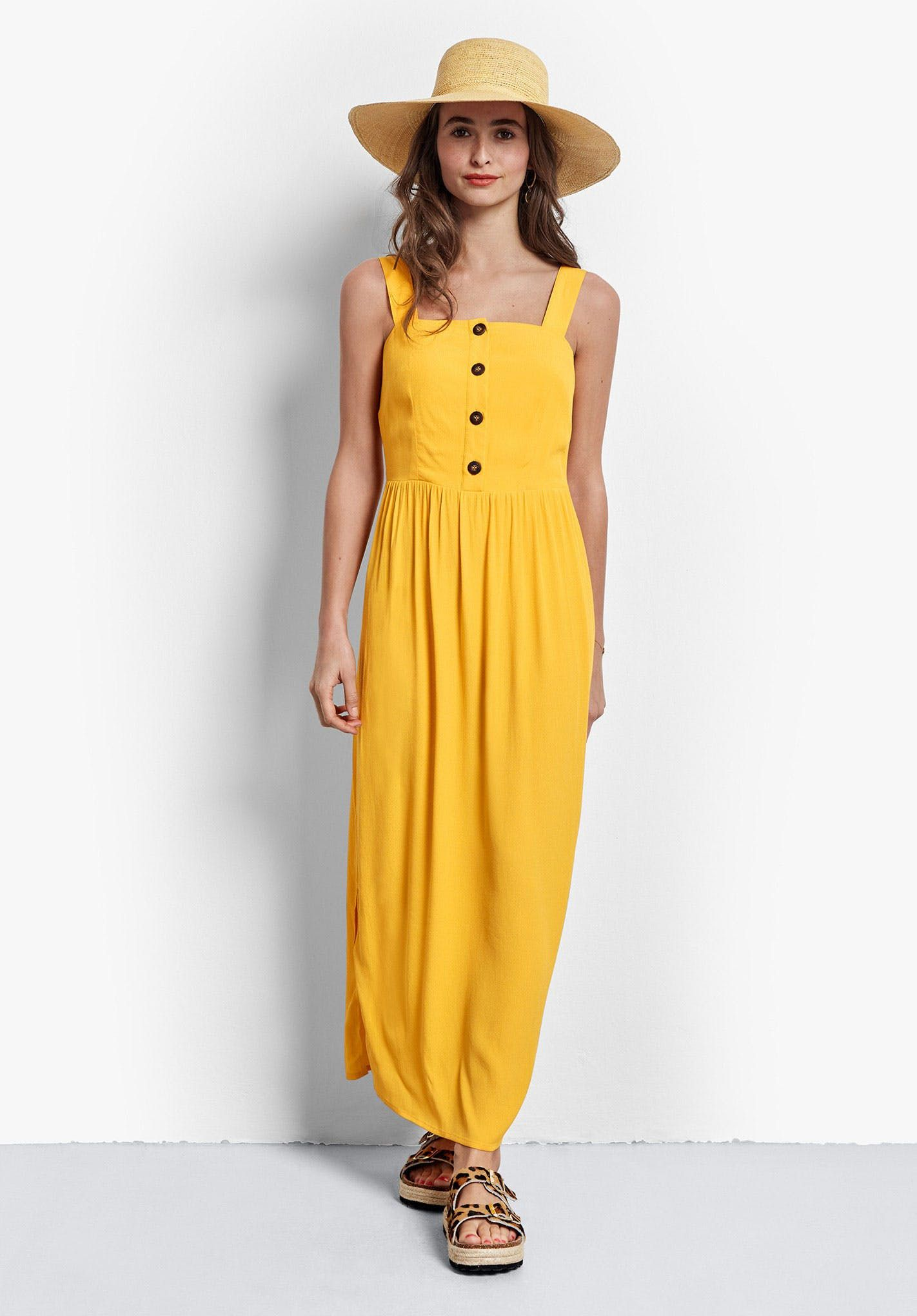 In A Gorgeous Sunshine Yellow Our Button Up Carilo Sun