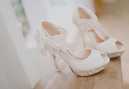 Defintely going to be my wedding shoes. Two things I love most, sparkle and lace!