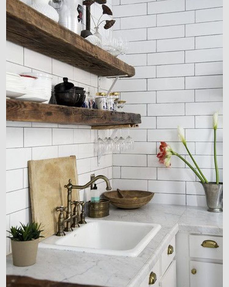 Love this kitchen!  The rustic shelves and full walls of time!  What do you love about it?  Image from @lonnymag