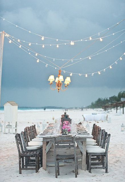 table setting on the beach, lanterns and light strings.  I like the Chandelier idea, but not necessarily that particular one