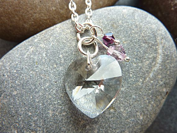 Swarovski crystal heart necklace on a silver plated chain. This is a very pretty clear crystal heart pendant necklace with 2 Swarovski beads