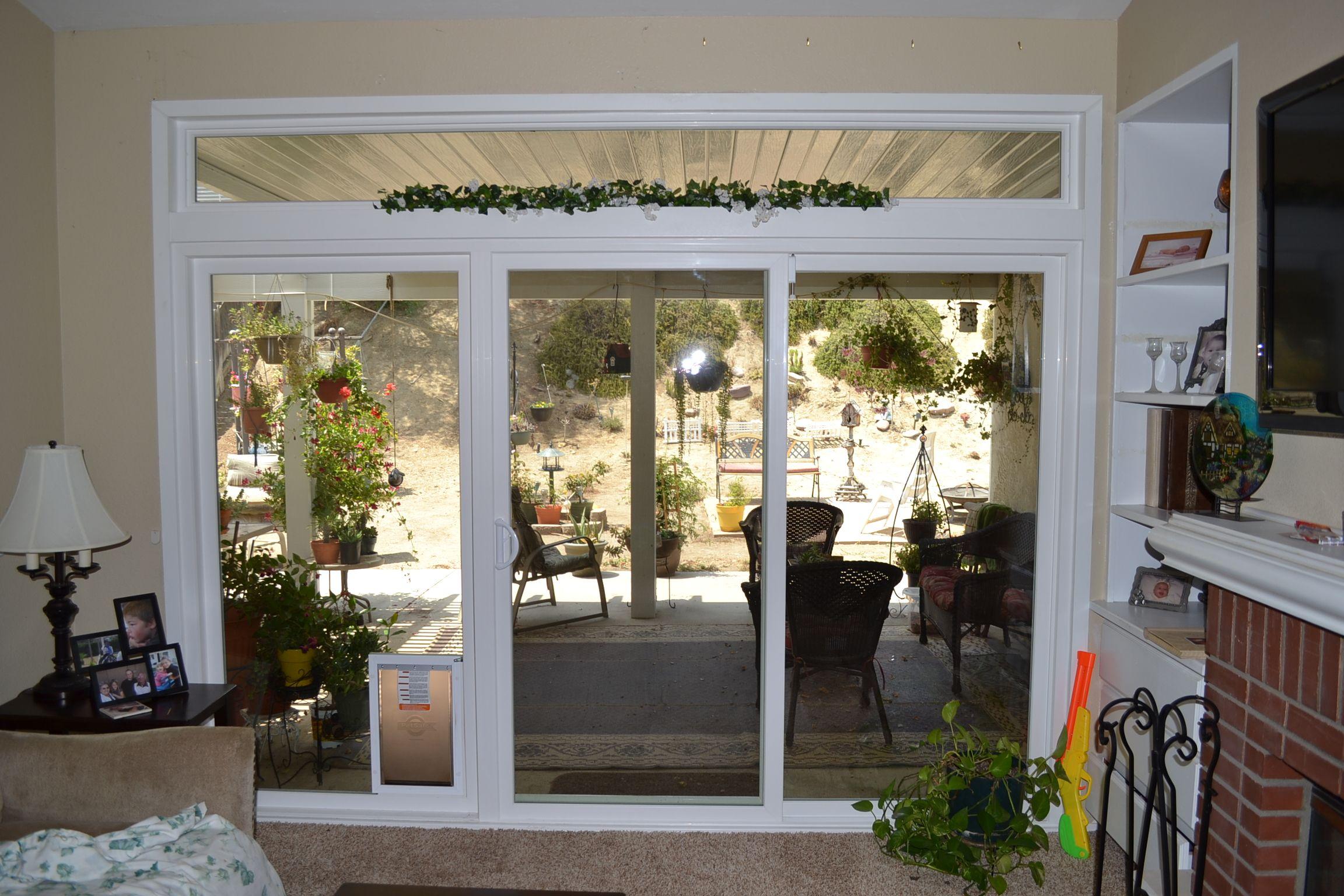 White Patio Doors Among Built In Dog Door Applying Clear Glass