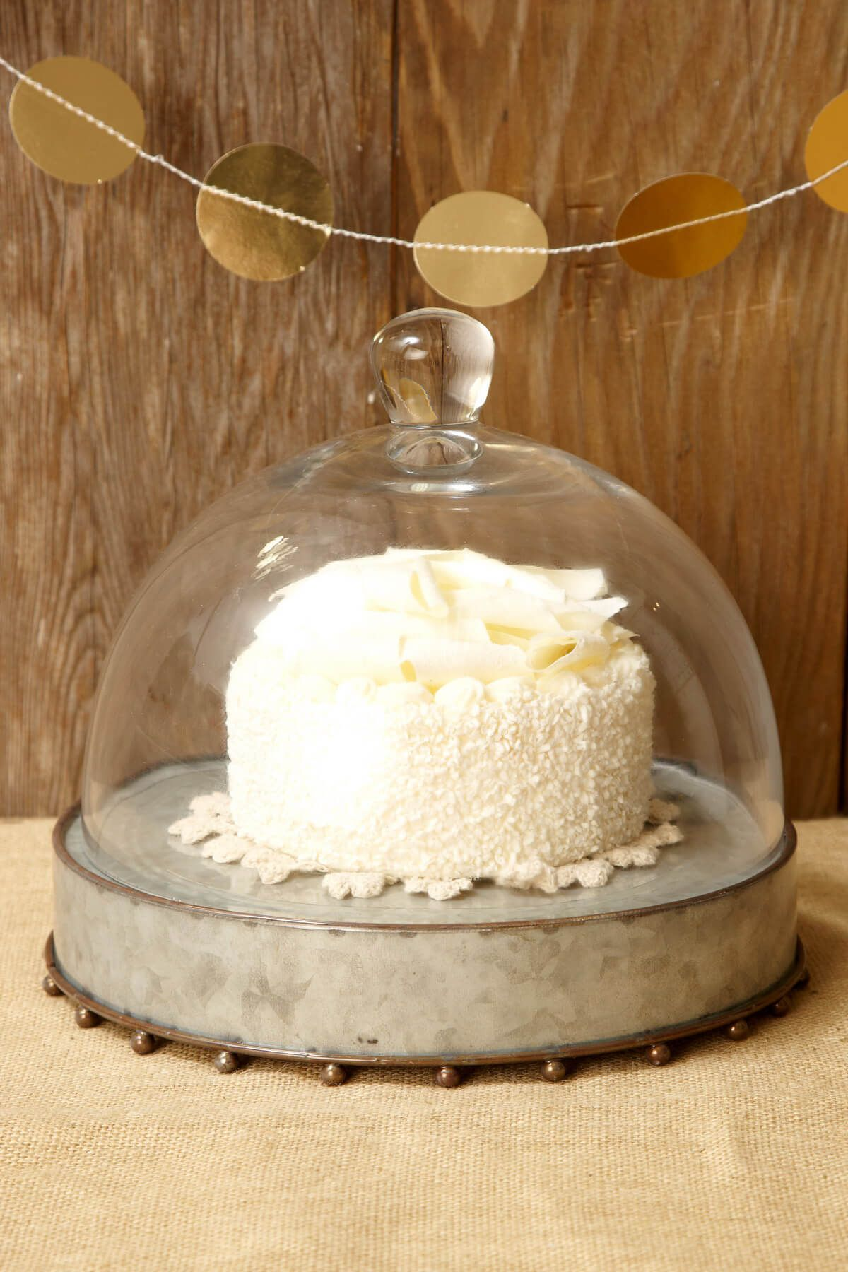 Metal cake stand with cloche perfect for rustic and farmhouse