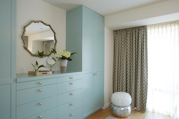 Chic Bedroom Features A 10 Drawer Blue Built-in Dresser