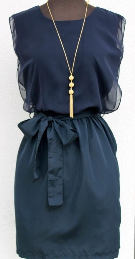 Navy dress, gold jewelry.