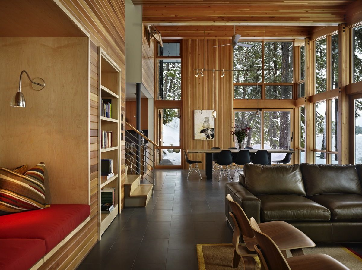 """This house on Lake Wenatchee in Washington was designed to be """"cozy for two and comfortable for a crowd.""""  The owners of the house, empty-nesters who have three kids in college, """"asked for a small and rustic modern cabin that would be flexible enough to accommodate the kids and their friends,"""" says DeForest. """"The challenge for us was to design a small house that could sleep from two to 15 people!"""""""