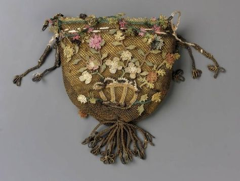 Date?? Small diamond mesh worked with brown silk.  Design: a basket of flowers on each side of bag worked in a variety of open-work stitches in colored silks (faded pinks, yellows, green and blues) Vitortia & Albert Museum