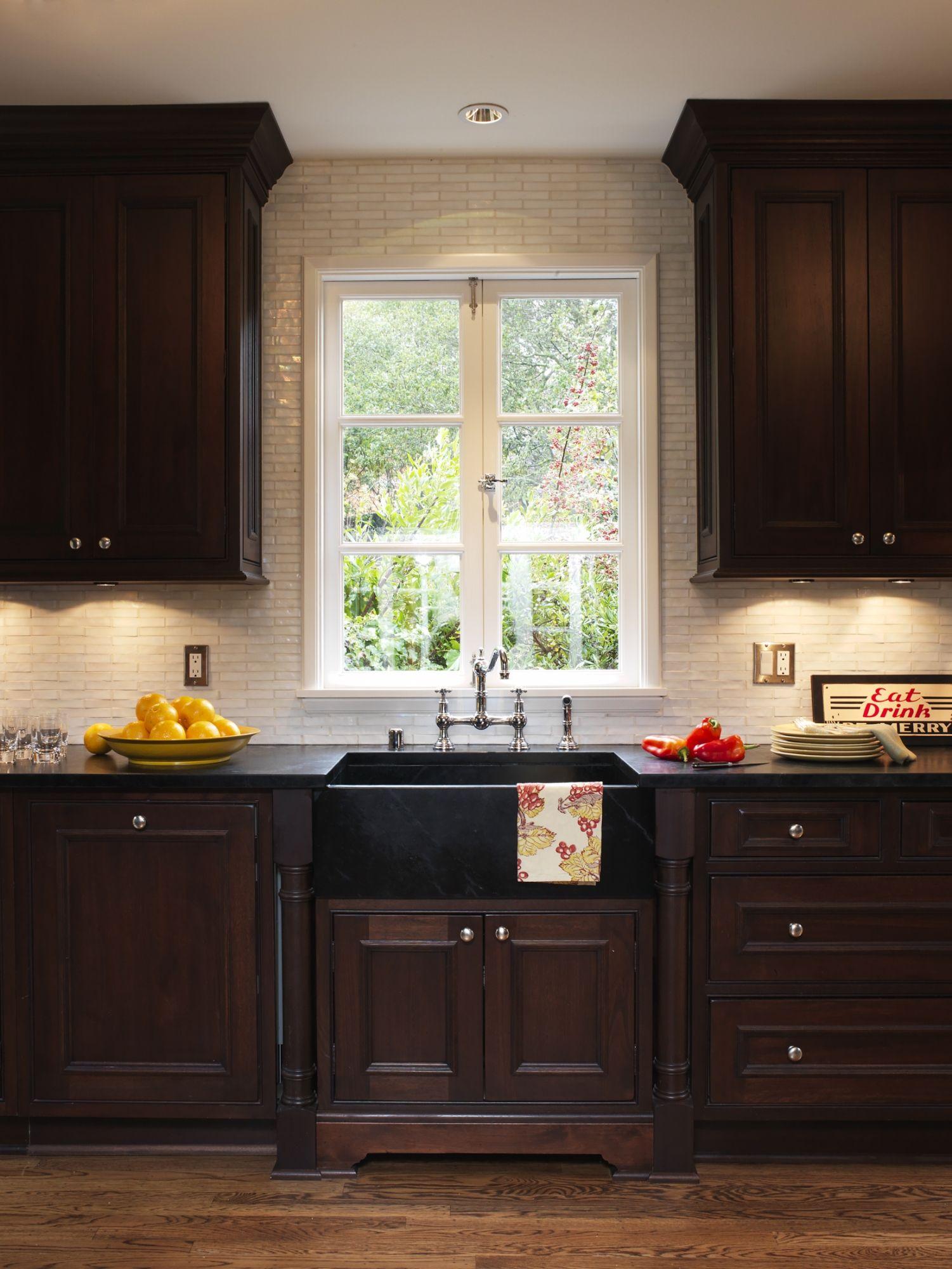 Soapstone countertop with apron sink in ebony Love the dark