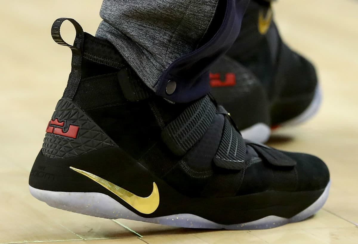 7abb22f762e LeBron James Debuts Nike LeBron Soldier 11 Black Gold Finals PE in Game 2