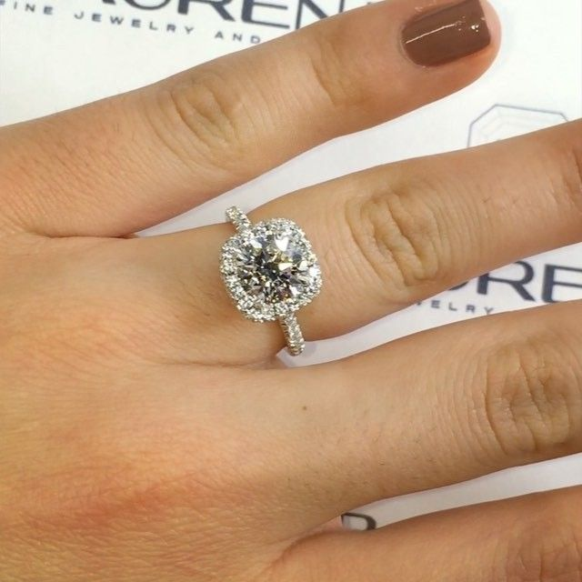 I could def go for a round diamond if it had a cushion halo!   Score one for team halo . 1.80 carat #rounddiamond in our double edged cushion halo design # RS-112.  The seamless yet delicate look of our halos are not what you see elsewhere.  In case you were leaning towards non-halo, this video might change your mind