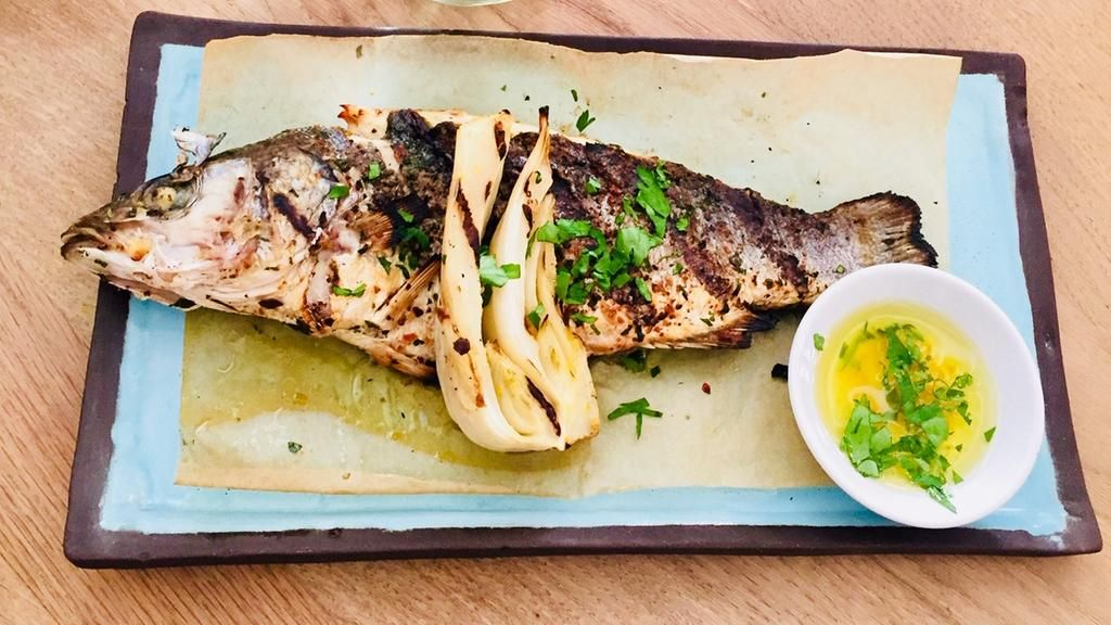 Delamina S Lime Rubbed Charcoal Grilled Fish Is Tel Aviv On A Plate Middle Eastern Restaurant Food Middle Eastern