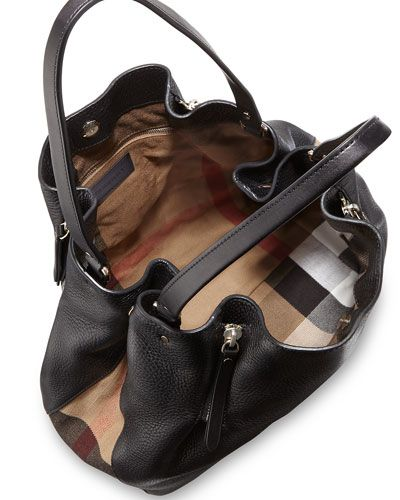 9dbecd4d1dc3 Burberry grained leather and signature check canvas tote bag. Shoulder  straps with rings. Snap-down gusset sides. Four exterior zips expand body.