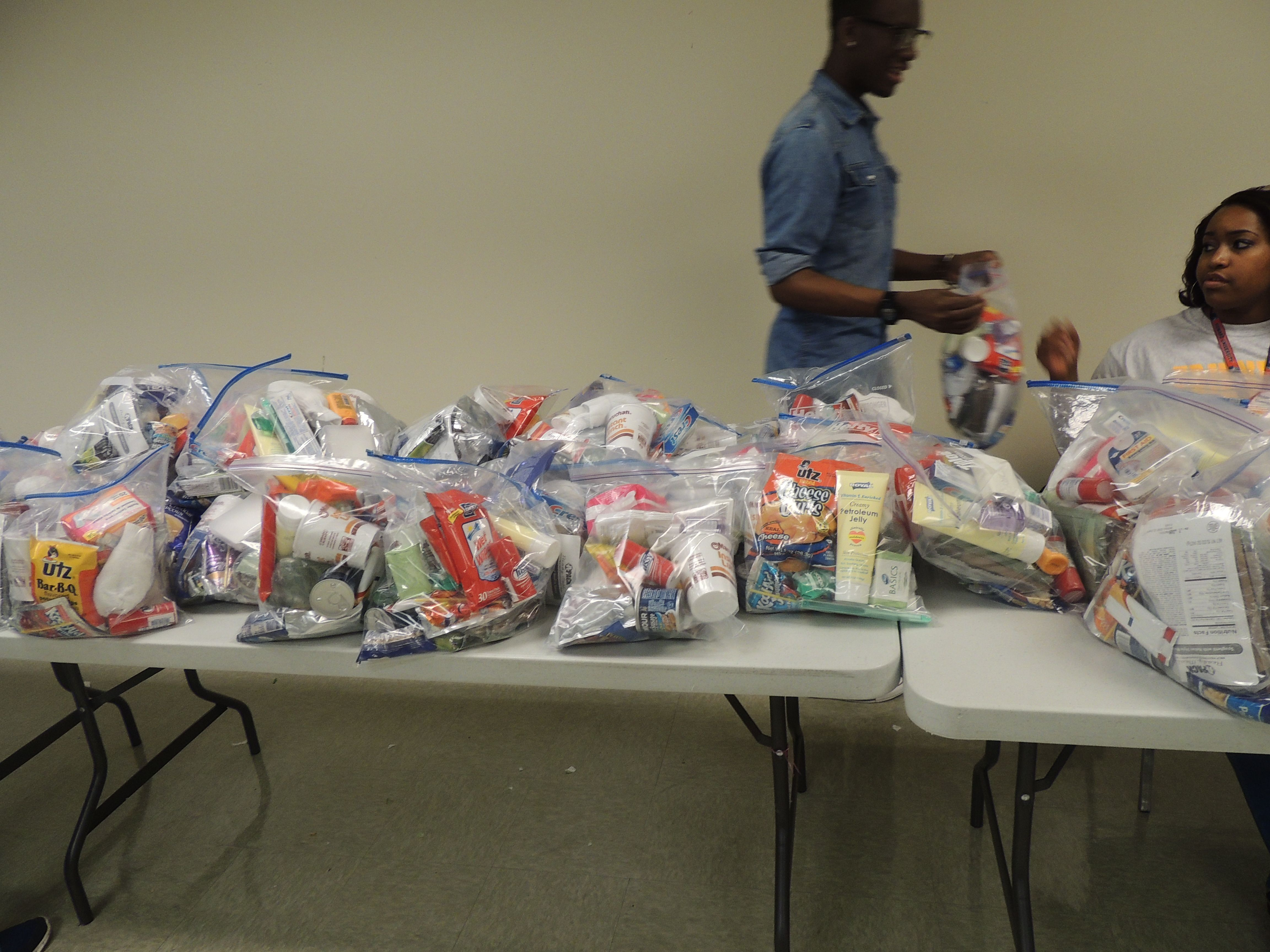 Our volunteers packaged food and hygienic essentials to give out to those in need.