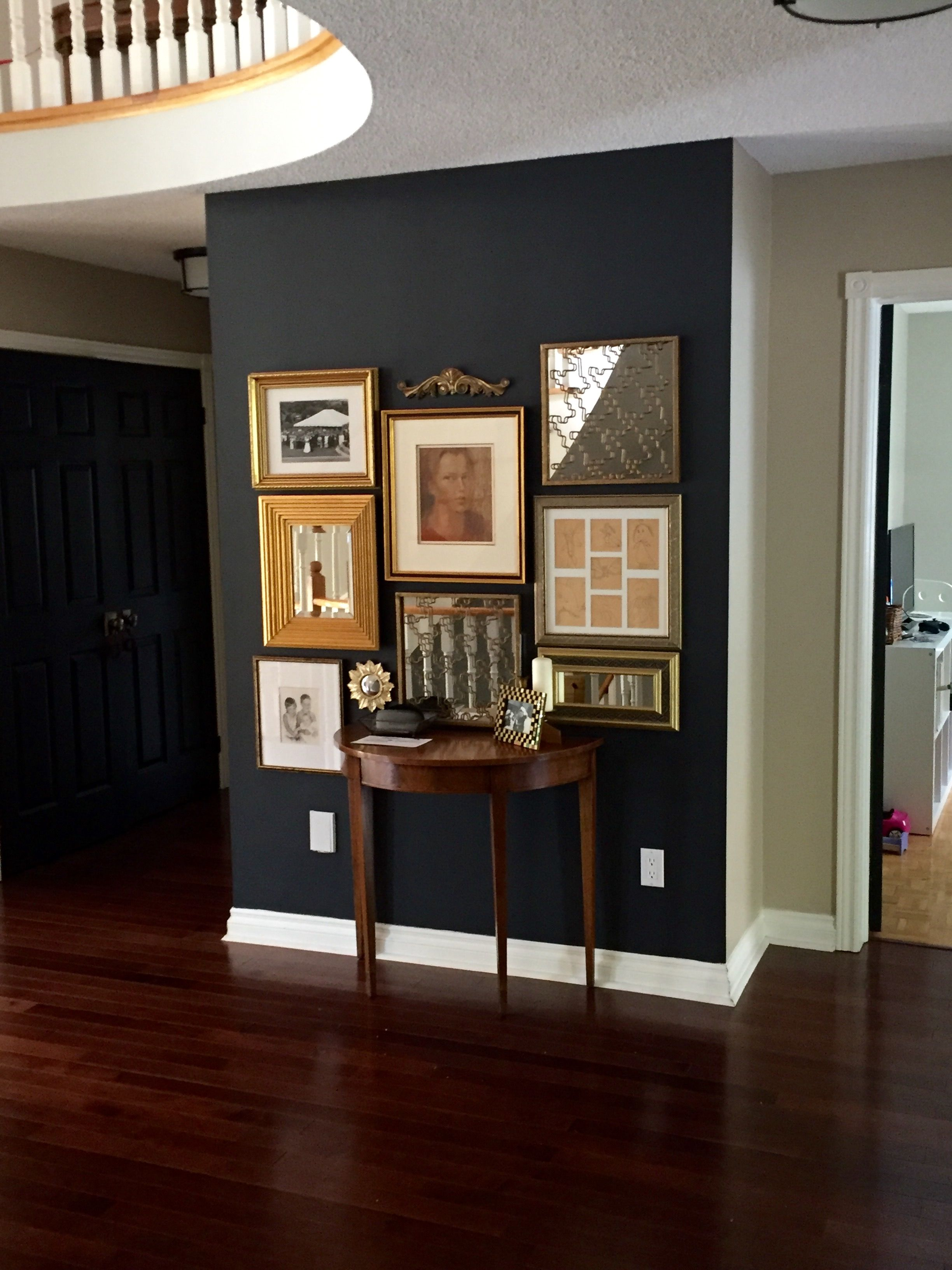 Benjamin Moore Wrought Iron Gallery Wall With Gold Frames Black Accent Wall Living Room Accent Walls In Living Room Black Accent Walls