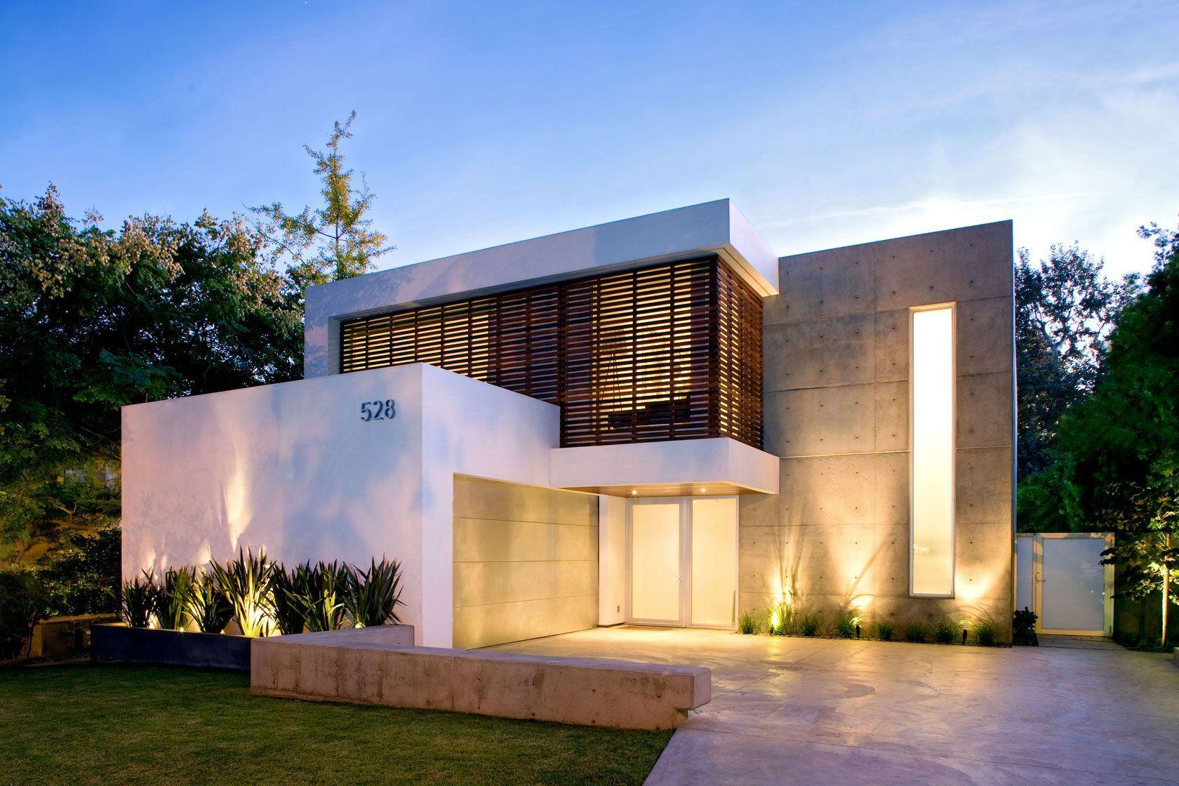 fachada de casa modernas de dos pisos con hormign y madera