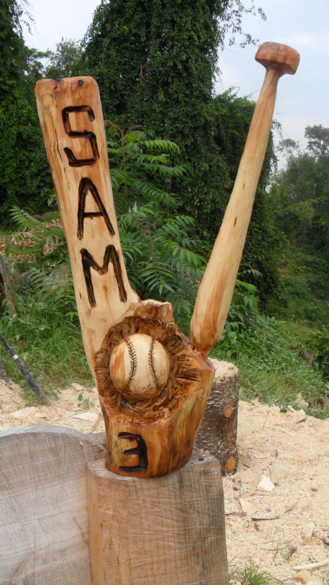 Chainsaw carved baseball and bat chainsaw carvings baseball