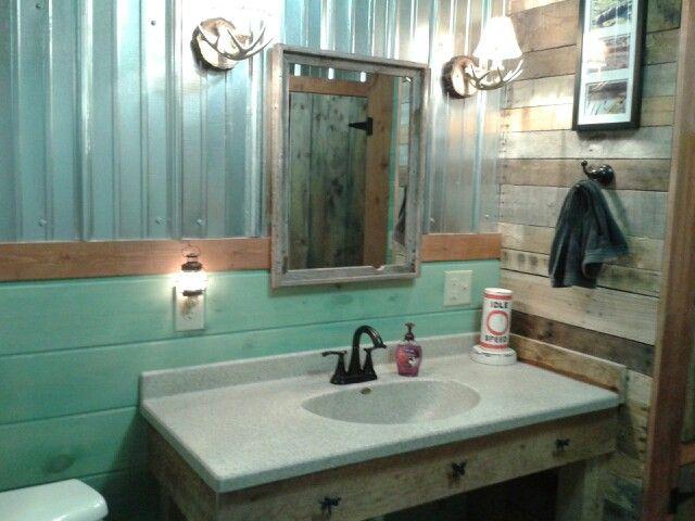 Man Cave Vanity : The sink vanity we built in . sconces have deer antlers on them