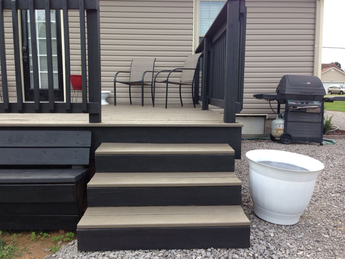 Two toned deck gray floor black rails for the home for Grey decking garden ideas
