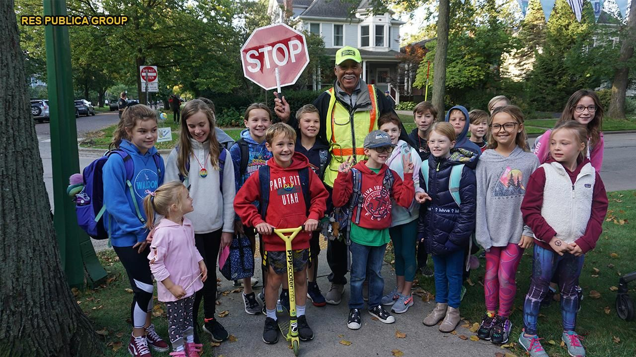 Community surprises crossing guard, known for putting