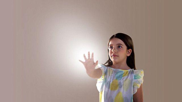 child-reaching-into-light
