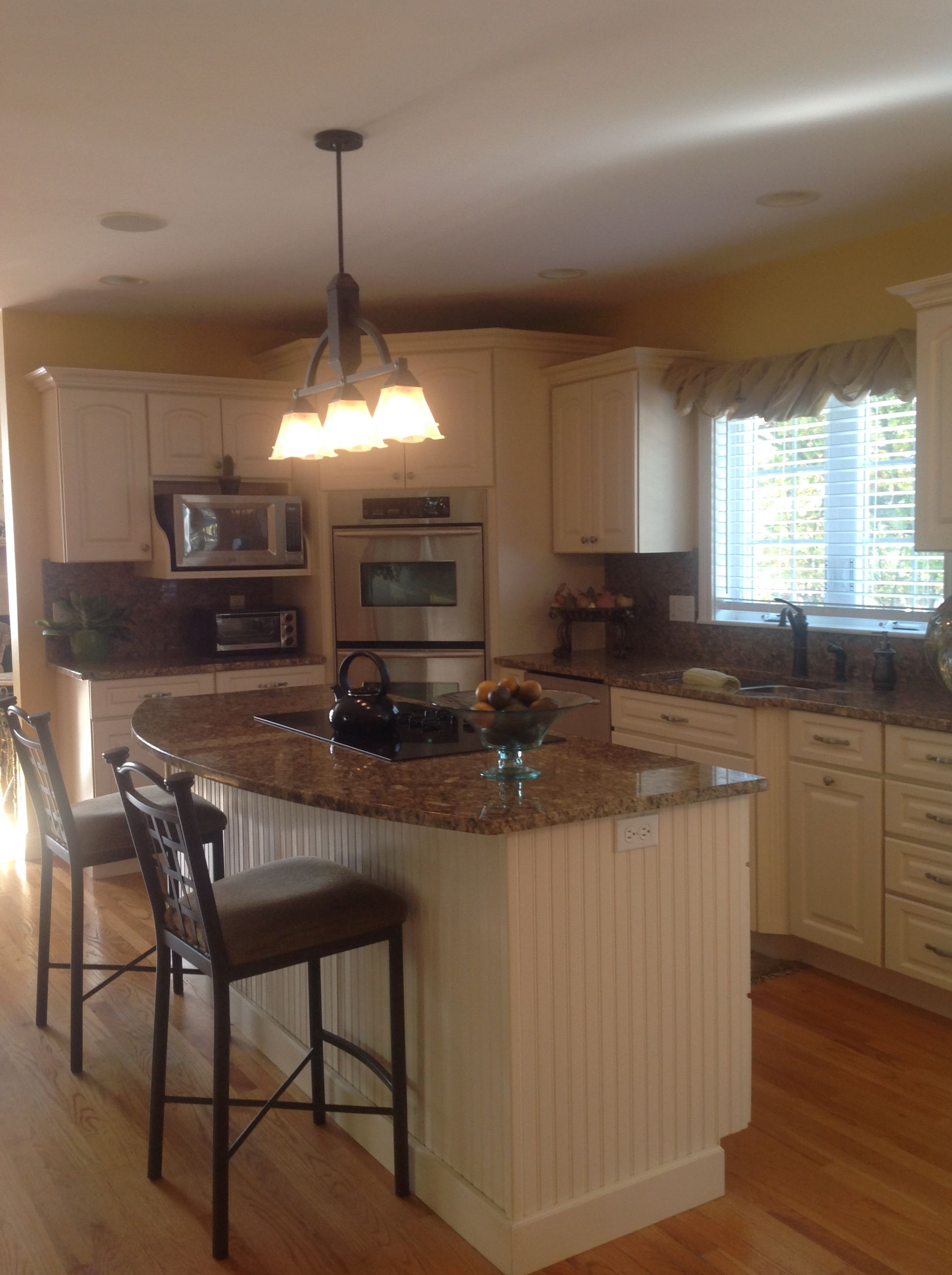 Granite topped kitchen island is warm and inviting