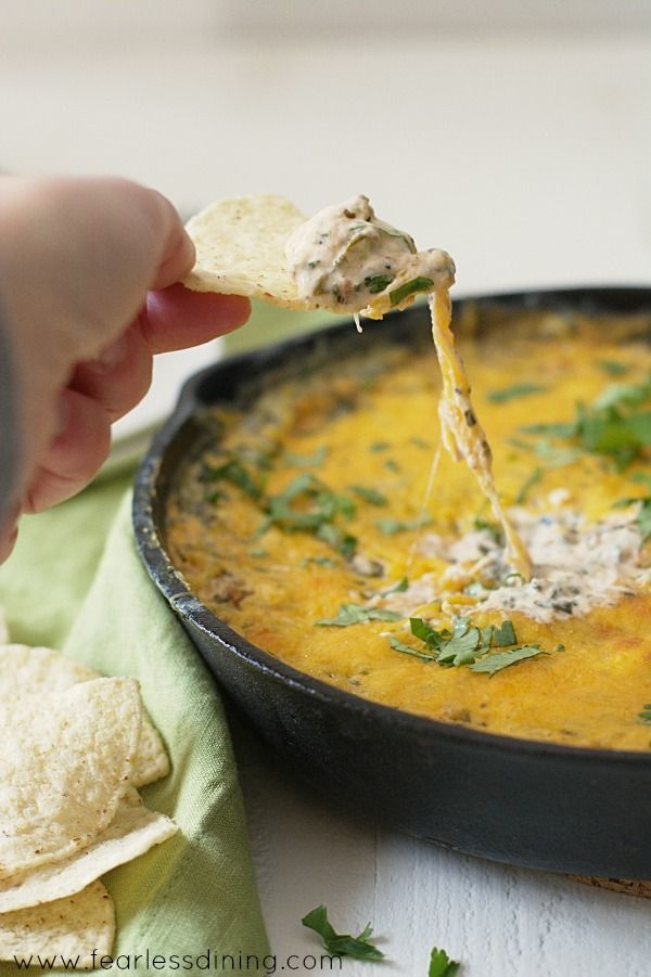 This creamy cheesy Southwestern Spicy Spinach and Corn Cheese Dip is so good! The perfect gluten free appetizer for entertaining.