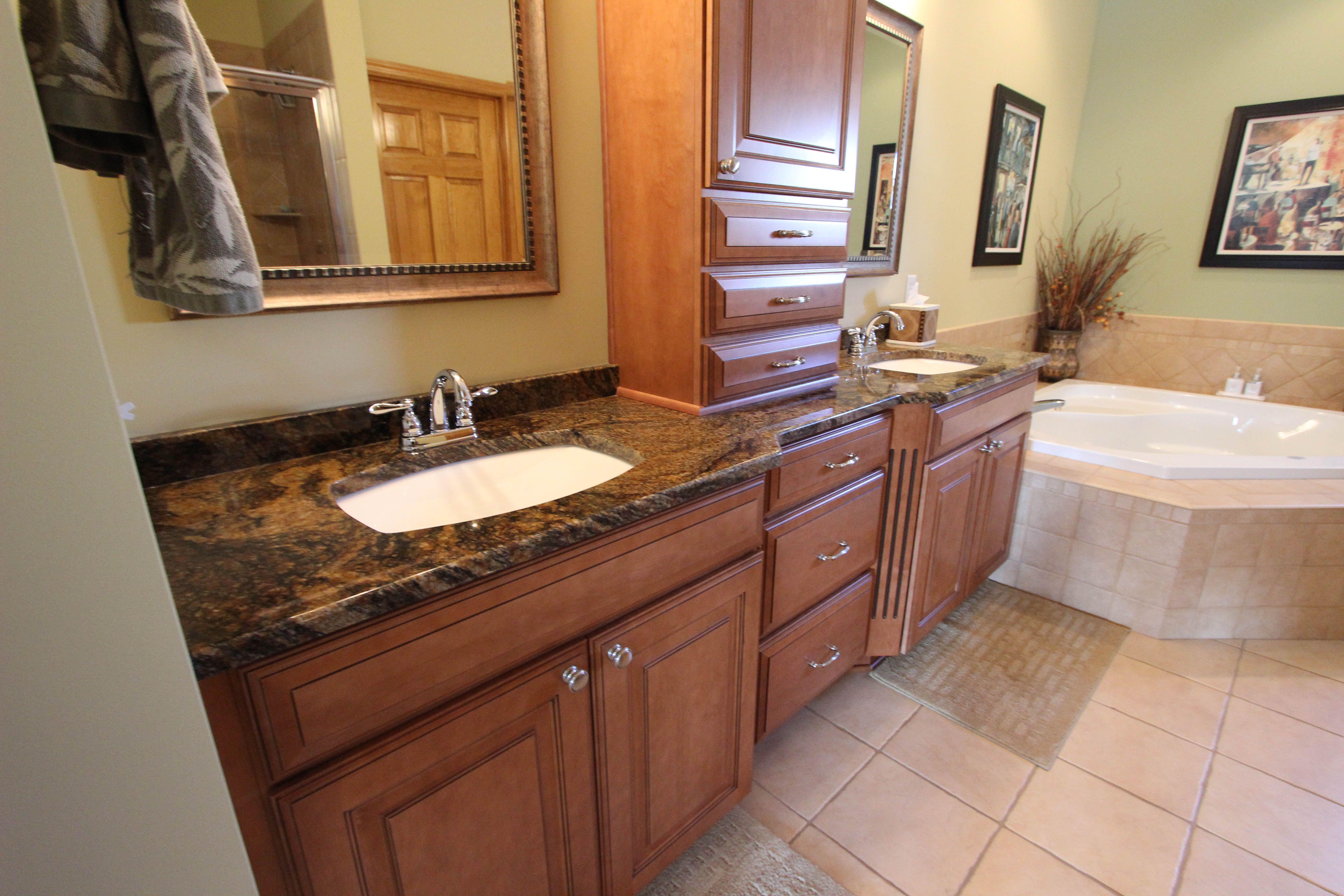 Double Sink Vanity With Tigers Eye Colored Granite Countertop