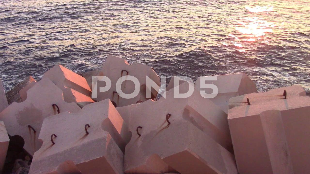 Blocks of artificial stones near the ocean Stock Footage stonesartificialBlocksFootage