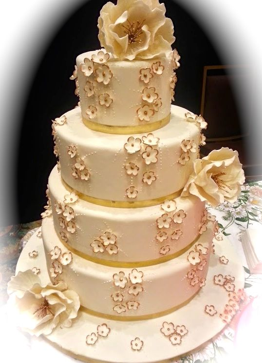 Towered white and gold cake.