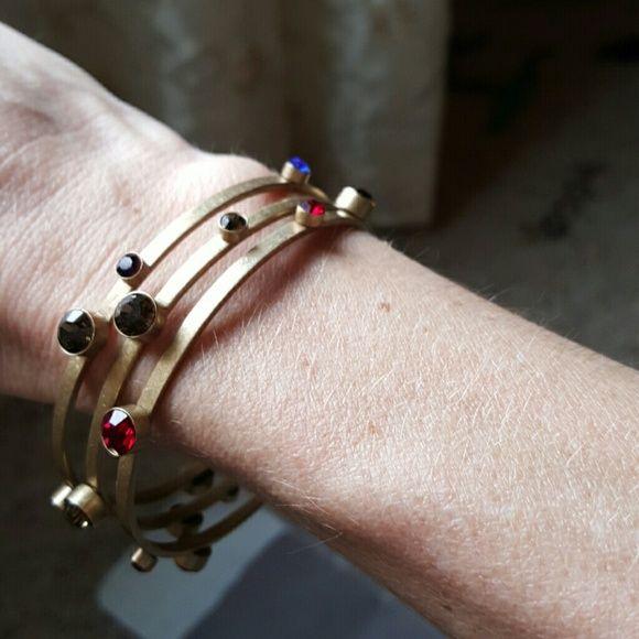 Lia Sophia Kiam Family jeweled bangles Like new Lia Sophia jeweled bangles. Red, green, blue, yellow and purple stones. Comes with the dust bag Lia Sophia Jewelry Bracelets
