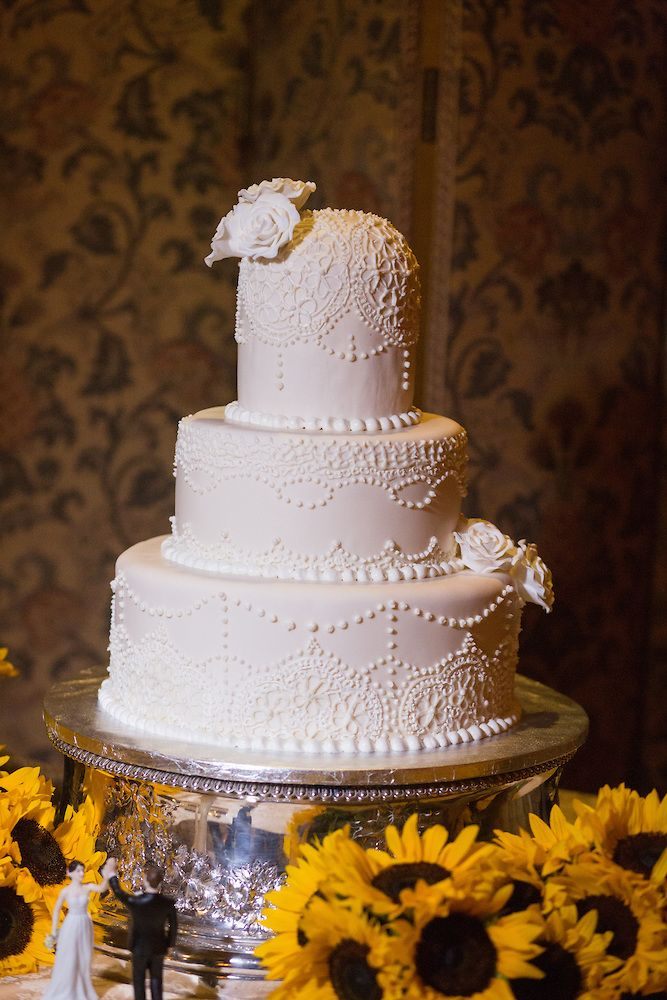 A delicate lace pattern covers this cake..with a fun topper on the side. View more  NJ NYC wedding  photography and videography by Blue Moon Video Productions  http://www.bluemoonvideoproductions.com #bluemoonvideo
