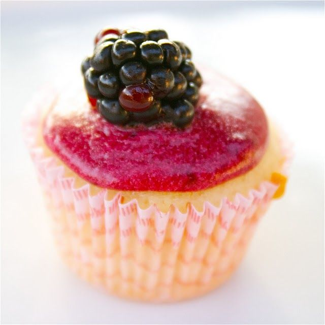 Mini vanilla cupcake with blackberry frosting?  Well, that looks scrumptious.