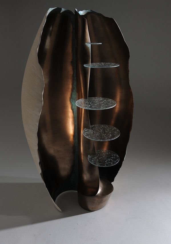 Designer Marc Fish's Babel cabinet opens to reveal a bronze interior.