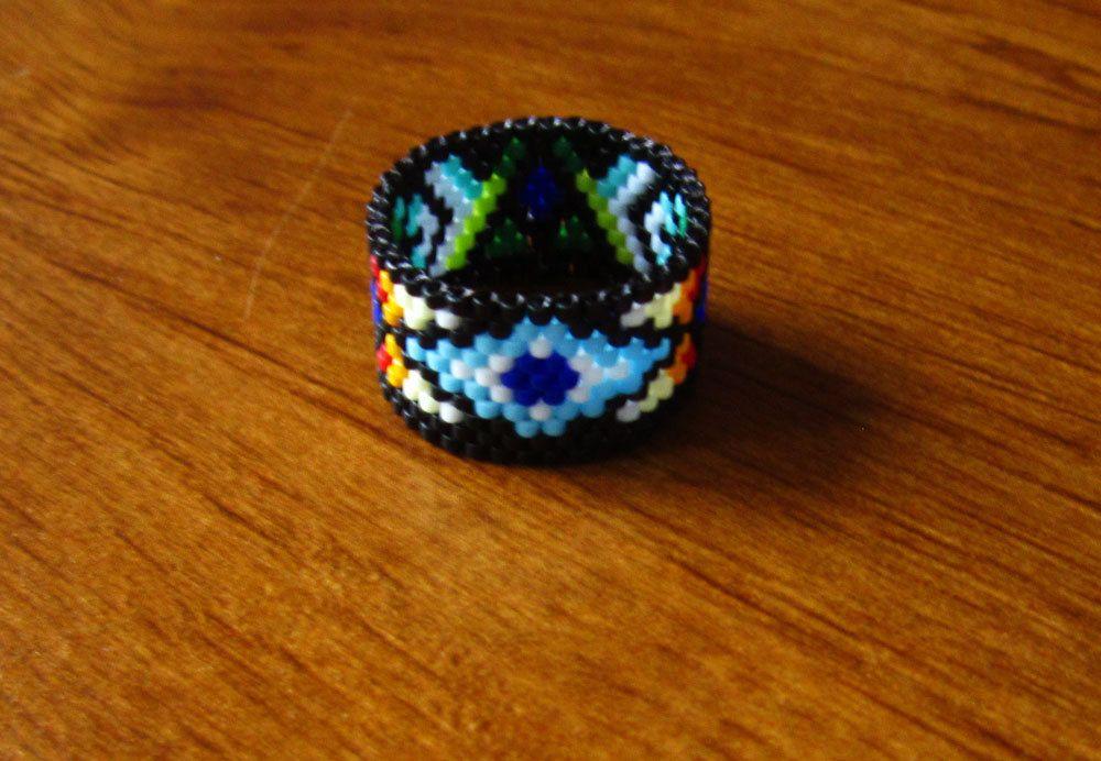 Rain Dreams Ring - Seed Beaded Peyote Stitch - OOAK size 9.5 by Elewmompittseh on Etsy https://www.etsy.com/listing/250371666/rain-dreams-ring-seed-beaded-peyote