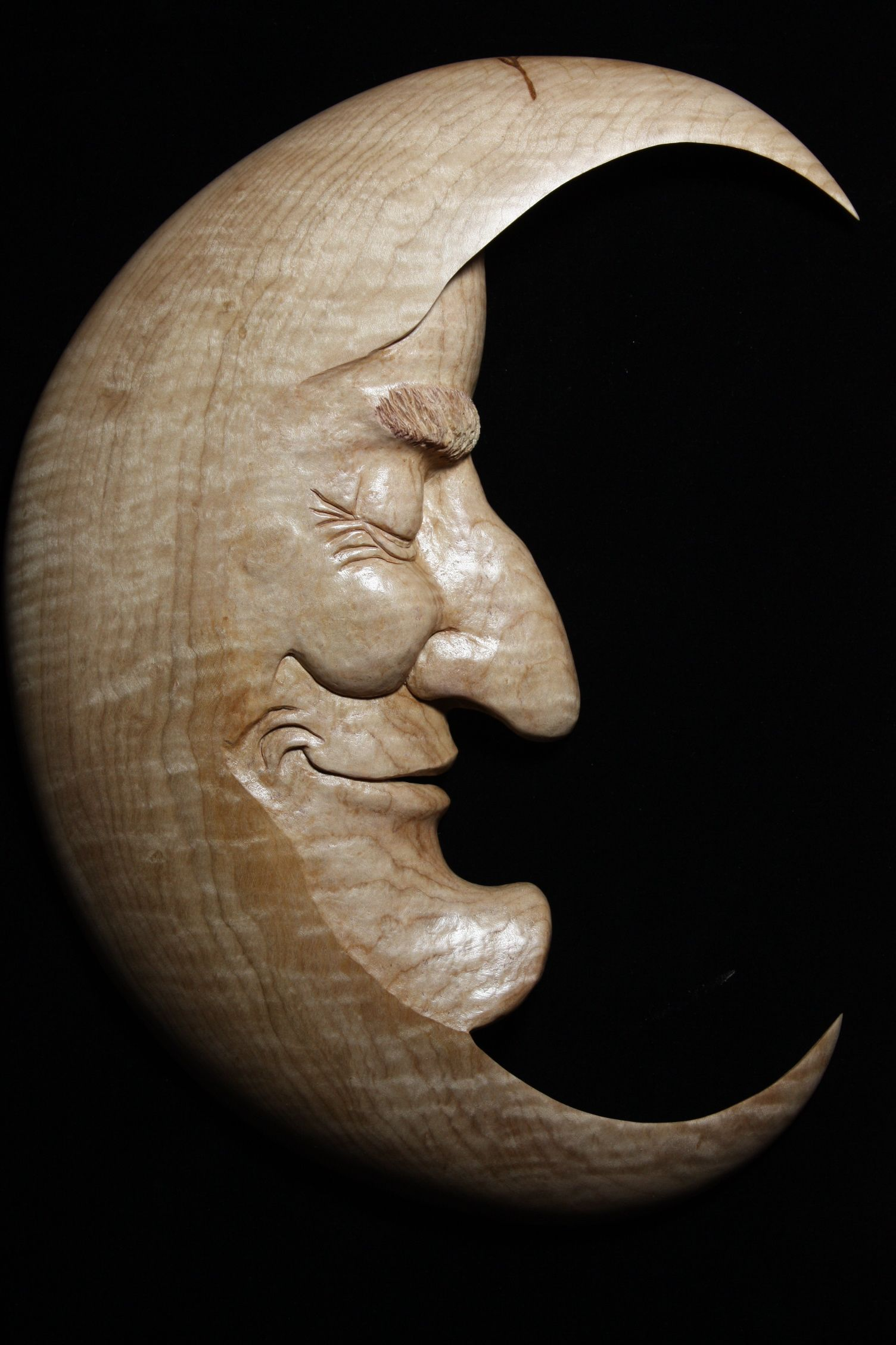 Man in the moon carved curly maple wood carvings