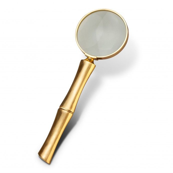 Bambou Magnifying Glass | $125,  Meticulously handcrafted from select metals and Limoges porcelain, L'Objet's desk accessories comprise a whimsical collection that is complex in color, rich in texture and global in design.
