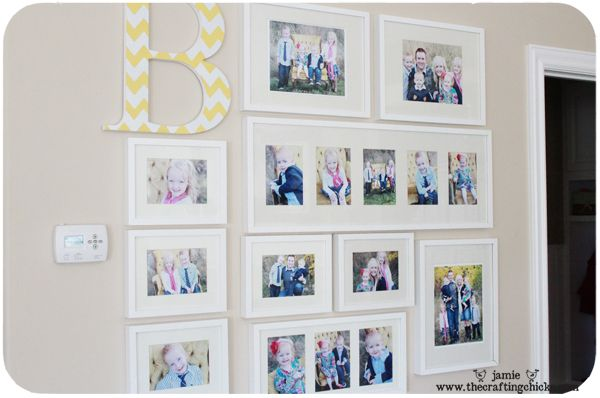 photo wall layout with monogram via The Crafting Chicks