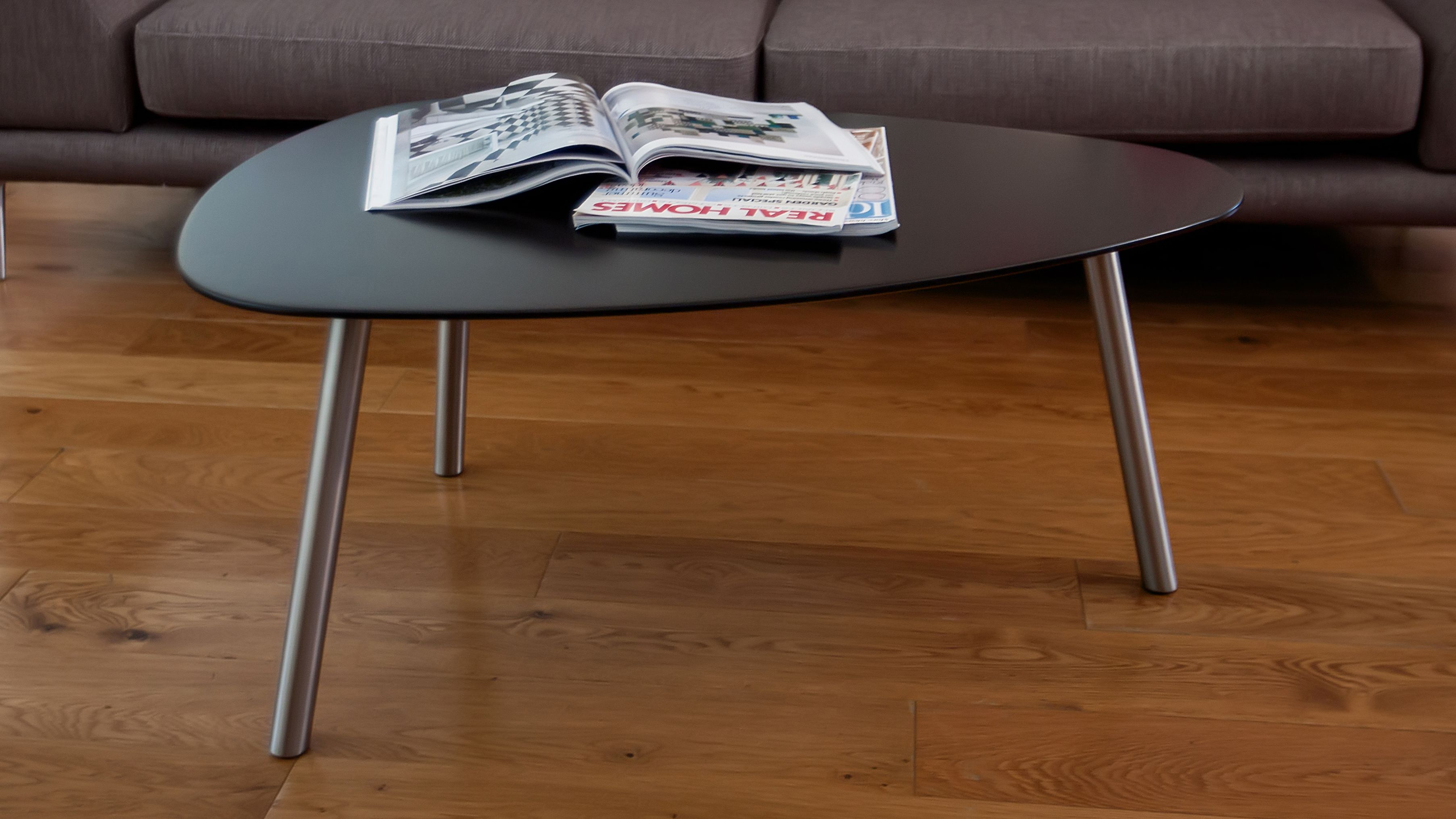The Assi Matt Black Coffee Table is modern in design supported by