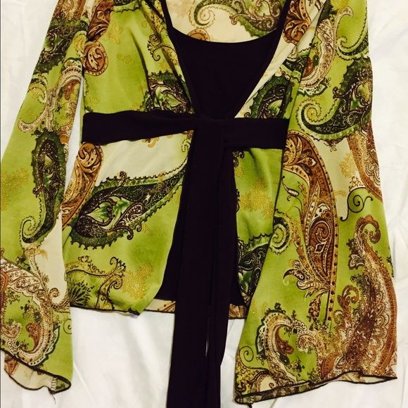 Green colorful with brown top. It's cute, thin material. Stretchy and comfortable. Tops Blouses