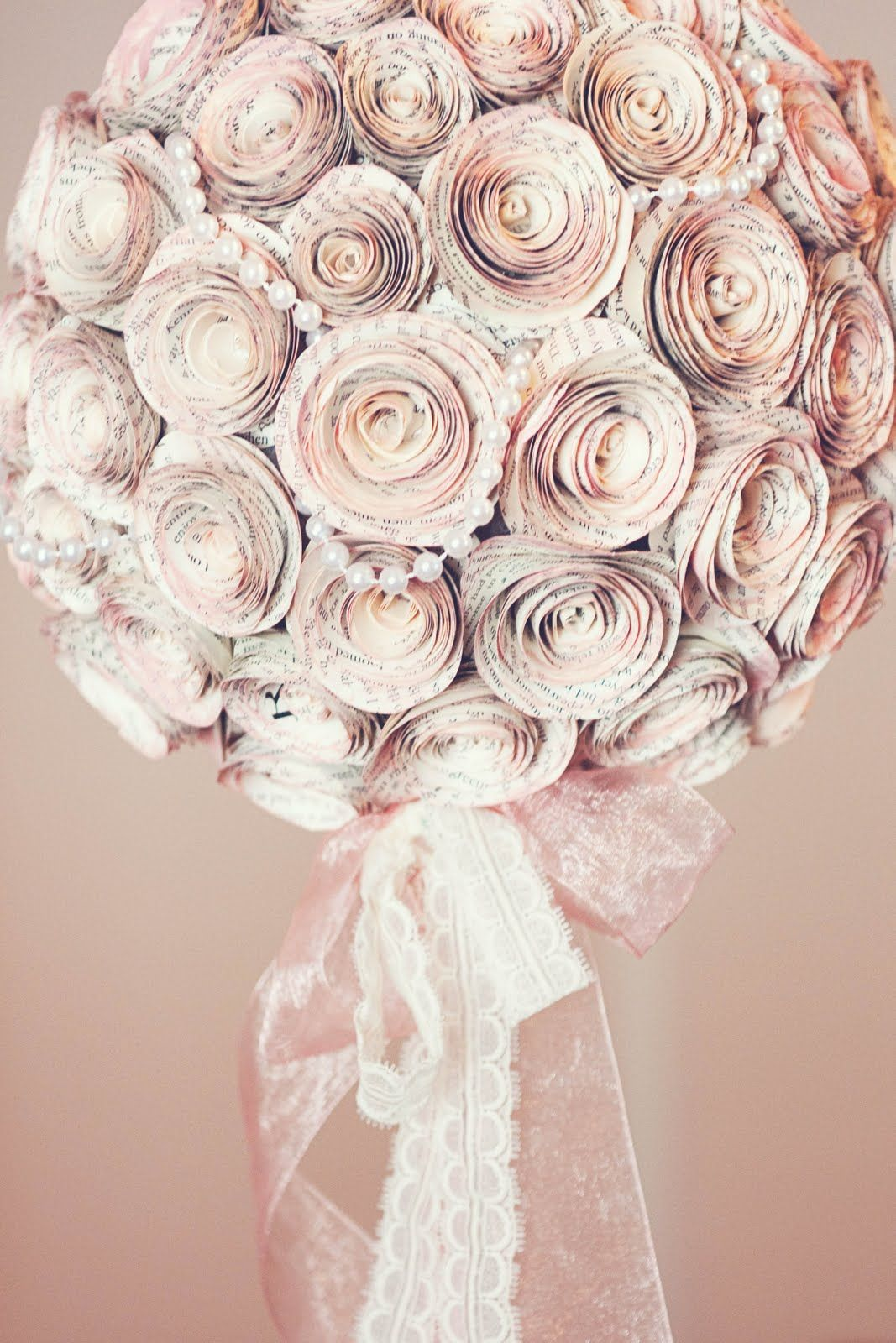 vintage book centerpieces wedding - Google Search (I like the pearls wrapped through the paper flowers, ti)